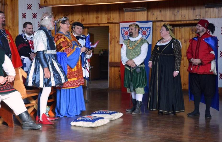 The Baron and Baroness of Krae Glas present a Captain Innilgard action figure to the outgoing Baron and Baroness of Innilgard. Photo by Lady Arganhell merch Briauc April 2014