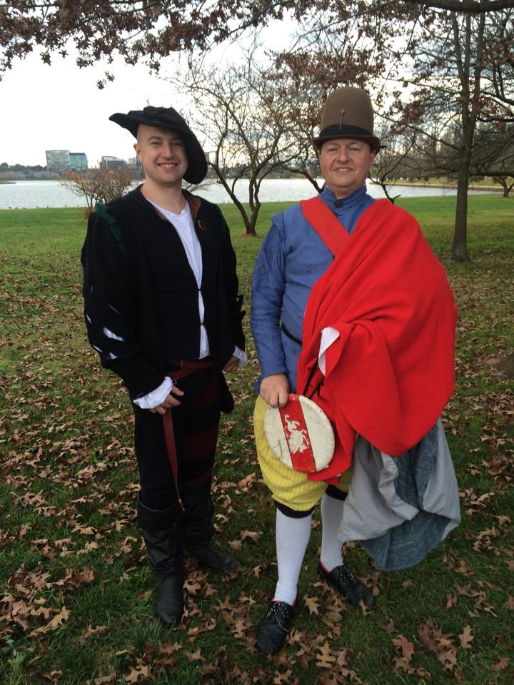 Lord Clement Valentine de Spieler (left) and Don François Henri Guyon (right), outgoing and incoming Baronial Rapier Champions for Politarchopolis 2014. Don Francois is wearing the regalia for the position (side cloak and buckler). Photo by TH Lady Ceara Shionnach.