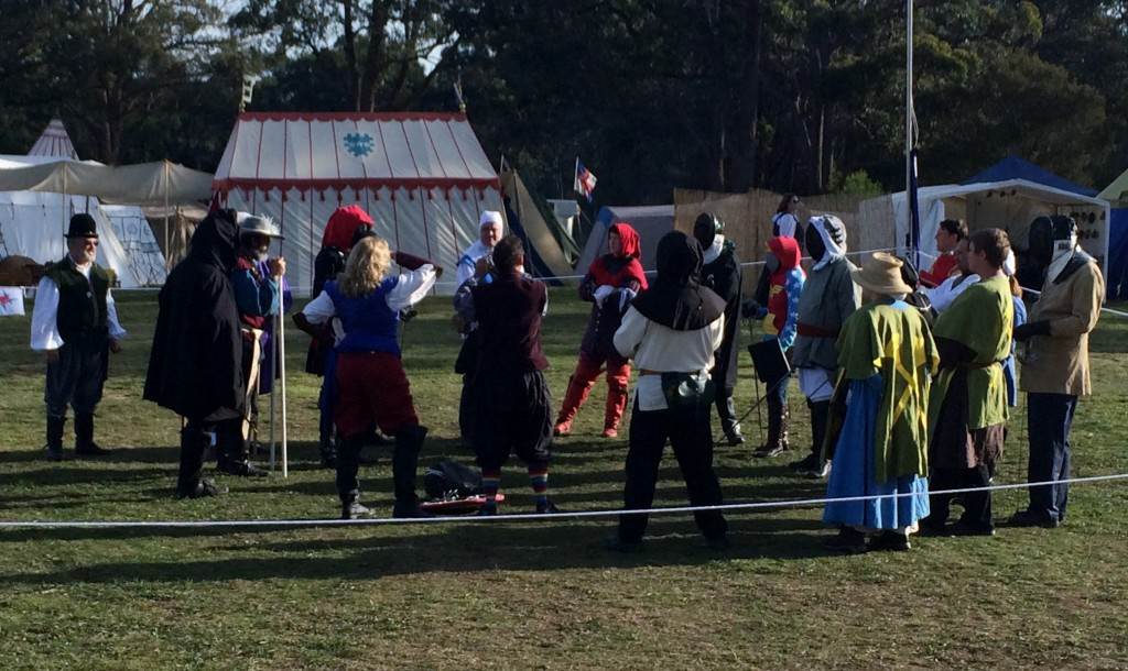 The entrants gather for instructions for the Heroes and Villains rapier tournament. Photo by THL Ceara Shionnach April 2014