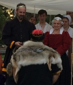 Count Sir Theuderic is presented with the extant spur for winning the H-FAT by the Baron and Baroness of Rowany. Photo by THL Ceara Shionnach April 2014