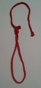 Token for the Red Knotted Noose. Photo by Baroness Eva von Danzig.