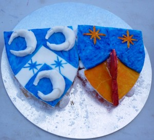 Sotelties made of Turkish delight topped by sugarplate, of Baron Aylwin Greymane and Baroness Ingerith Ryzka's heraldry. Made by Baroness Blodeuwedd y Gath. Photo by Lady Ursula Von Memmingen, April 2014