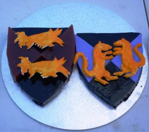 Sotelties predominantly made of Blackberry Gelli of Baron Dai Bach and Baroness Alycie of Stirling 's heraldry  with elements completed in quince paste and sugarplate. Made by Baroness Blodeuwedd y Gath. Photo by Lady Ursula Von Memmingen, April 2014