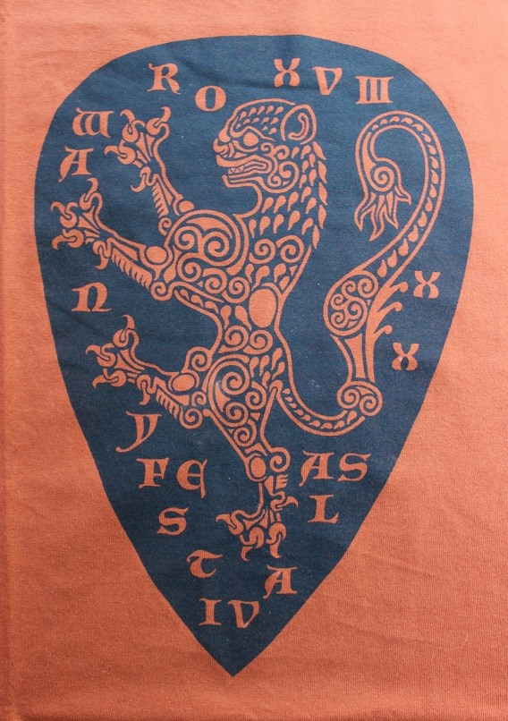 The Rowany Festival t-shirt design for AS38 of a lion shield. Photo and design by Lady Eloise Darnell