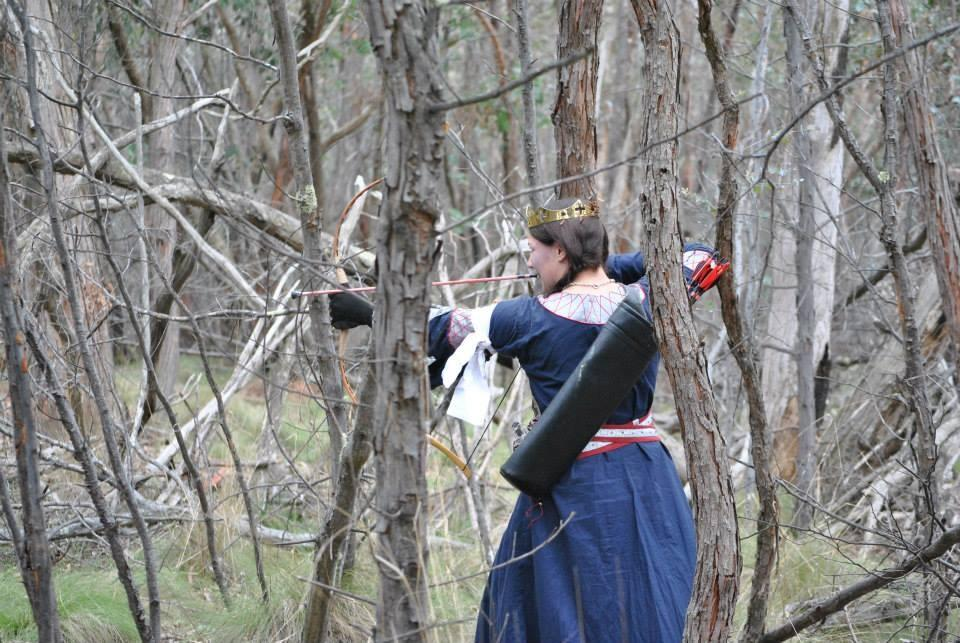 Liadan doing some archery with combat blunts in the woods. Photo by Lady Sophia van Dorne, 2013