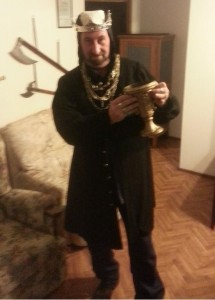 Baron Yevan of Innilgard wearing copious gold chains and rings, with a giant gold drinking cup. Photo provided by Baron Yevan de Leeds, June 2014