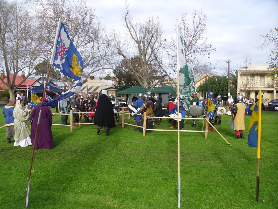 Heavy combat over the barrier at Stormhold Baronial Investiture AS49. Photo by Sir Hugh the Little, June 2014