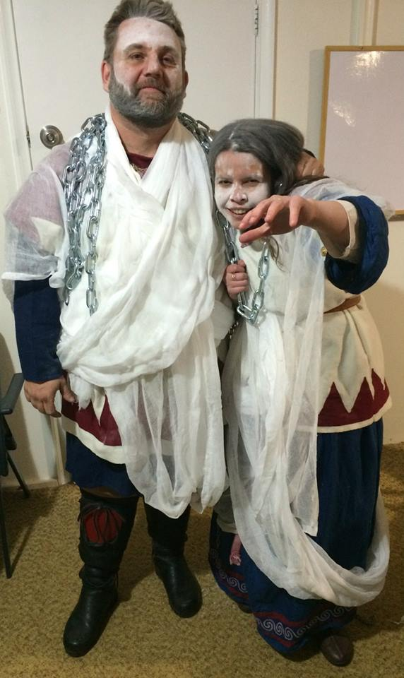 After they stepped down as Crown of Lochac, Alfar and Angharat proceeded to haunt the Midwinter Feast. Photo by TH Lady Ceara Shionnach, July 2014