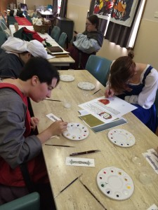 Scribal class by TH Lady Katherne. Photo by TH Lady Ceara Shionnach, July 2014