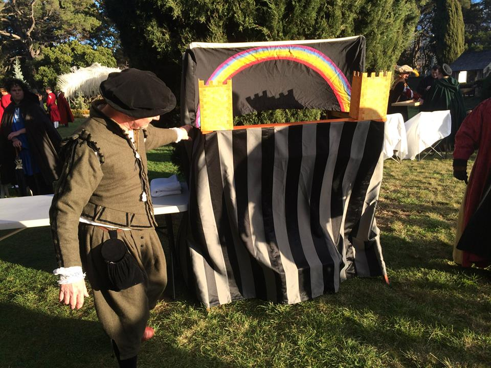 Lord Nicodemus and Mistress Rowan put on a puppet show. Photo by TH Ceara Shionnach, July 2014