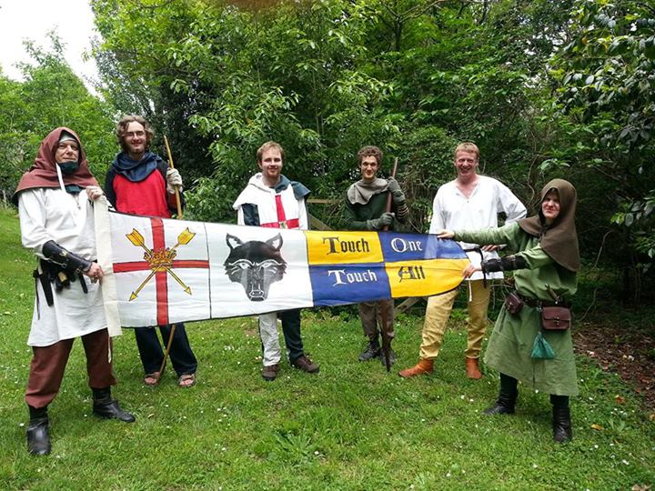 Some members of the Wulfing Household holding a household banner. Photo obtained from Geffrey đe Wulf.