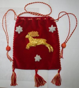 One example of a pouch that may be given to the recipient of Lochac's Order of Grace, 16th century style bag by TH Lady Ceara Shionnach, photo by Mistress Rowan Perigrynne.