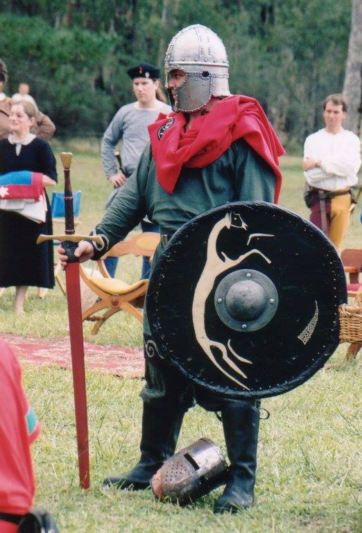 Sword the Bastard holding Lochac's first Sword of State at Rowany Festival 2002. Photo by John of the Hills, 2002.