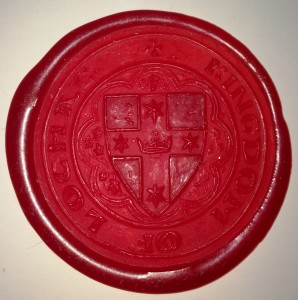 Lochac's Great Seal of State, as stamped into red wax. Photo by Lochac's College of Scribes.
