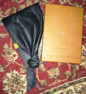 Two of the leather-bound books given to Count Niall inn Orkneyski and Countess Liadan ingen Fheradaig, photo by TH Lady Ceara Shionnach.