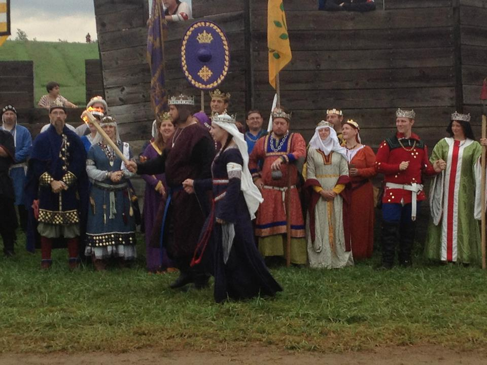 Their Majesties Niáll inn Orkneyski and Liadan ingen Fheradaig at opening court, having lit their torch with the flame of the Mid Realm (thus pledging Their allegiance for the war) at Pennsic War 42 (AS 48, 2013). Photo by TH Lady Ceara Shionnach.