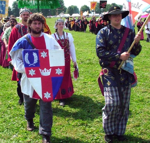 Lochac processing to court at Pennsic War 33 (AS 39, 2004) with Their Majesties Draco of Jorvik and Serena of Black Ness. Photo by Constanzia Moralez y de Zamora.