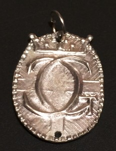 Pewter badge cypher from the reign of Gabriel II and Constanzia II. Photo by TH Lady Ceara Shionnach.