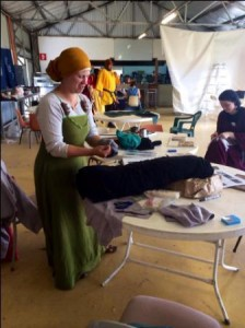 The Honourable Lady Heilwich Gheerts teaching her A&S class on fitting hosen. Photo by TH Lady Ceara Shionnach, November 2014.