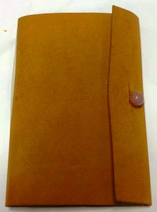 The event token for Canterbury Faire AS49 was a small leather book for writing event notes in. Photo by THL Ceara Shionnach, January 2015.