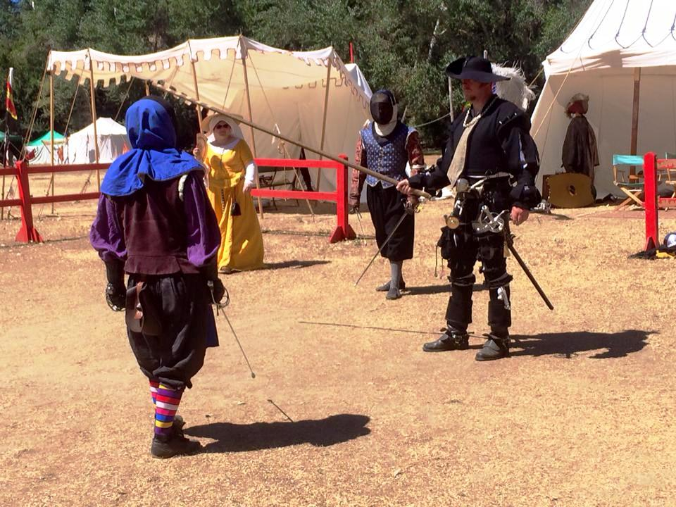 Don Gomez de Crecy and Don Gregory Tortouse de Sloleye in the finals of the Baronesses Rapier Tournament. Photo by THL Ceara Shionnach, January 2015.