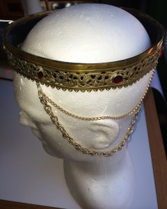 The second coronet worn by Mistress Rowan Perigrynne as Baroness of Rowany. This coronet was a gift to Mistress Rowan from SCAdians in the U.S. during the Kingdom Shopping Expedition in 1982. Photo by THL Ceara Shionnach, 2014.