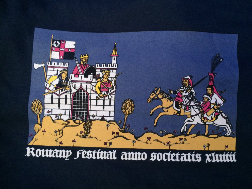 Mistress Eloise Darnell designed the Rowany Festival AS49 t-shirt. It depicts Kinggiyadai Khagan and Altani Yeke Khatun (bottom right) riding to lay siege to a castle protected by Duke Niall inn Orkneyskii, Duchess Liadan ingen Fheradaig and Countess Engelin Teufel. Photo by THL Ceara Shionnach, April 2015.