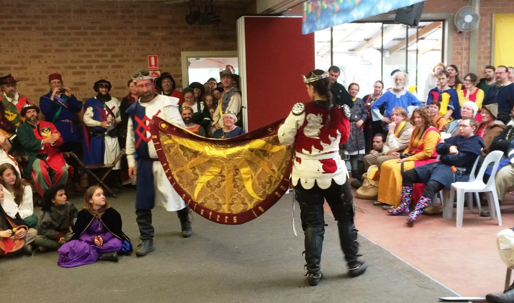 Baron Yevan de Leeds and Baroness Eva von Danzig of Innilgard present the Heroes Cloak to the Crown. Photo by THL Ceara Shionnach, April 2015.