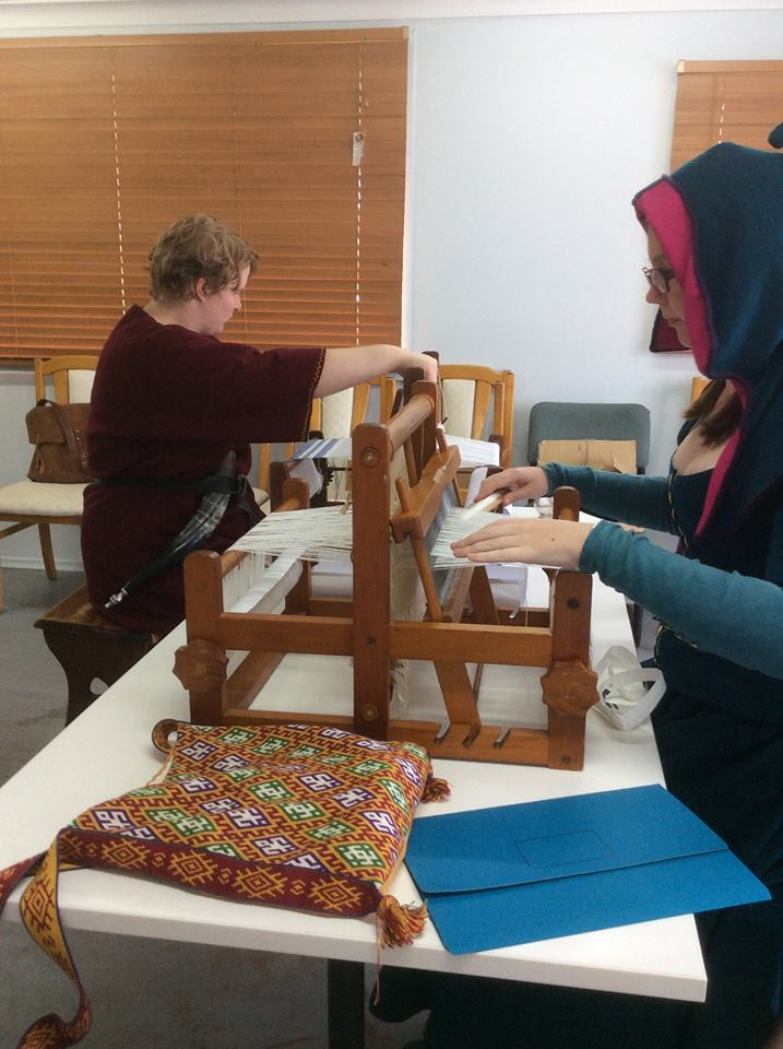 A photo of the napkin weaving class run at Festival AS49 by Lady Aleinya Thrakesina. Photo by Lady Aleinya Thrakesina, April 2015.