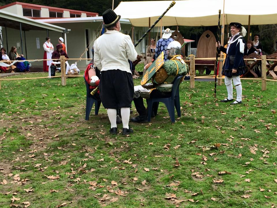 Sir Callum and Sir Brusi fought their bout on chairs, which entertained onlookers. Photo by THL Ceara Shionnach, May 2015.