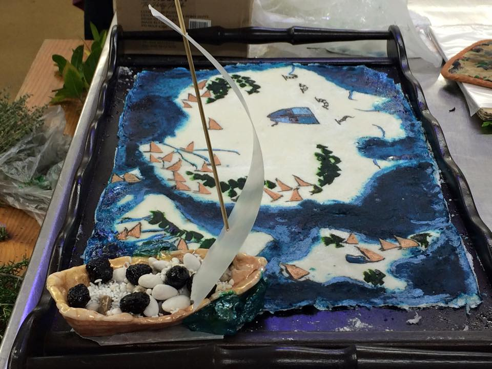 The soteltie at the feast included a map of Lochac, including the ocean and a ship. Photo by THL Ceara Shionnach, May 2015.