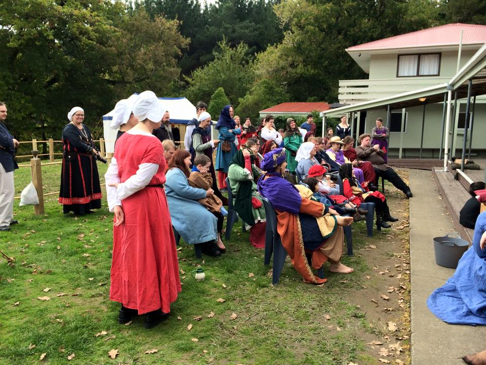The crowd gathered to watch the puppet play at May Crown ASL. Photo by THL Ceara Shionnach, May 2015.