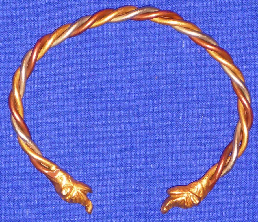 Lochac's Bardic Bracelet token. Photo by The Honourable Lord Gilligan O'Tomelty, June 2016.