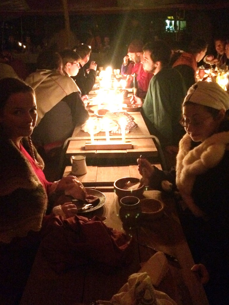 Feast goers illuminated by candle light. Photo by TH Lady Ceara Shionnach, June 2015.