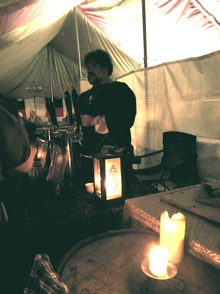 Duke Sir Allaric of Bangor serving in the Jolly Duke Tavern. Photo by Lady Amalia del Benino.