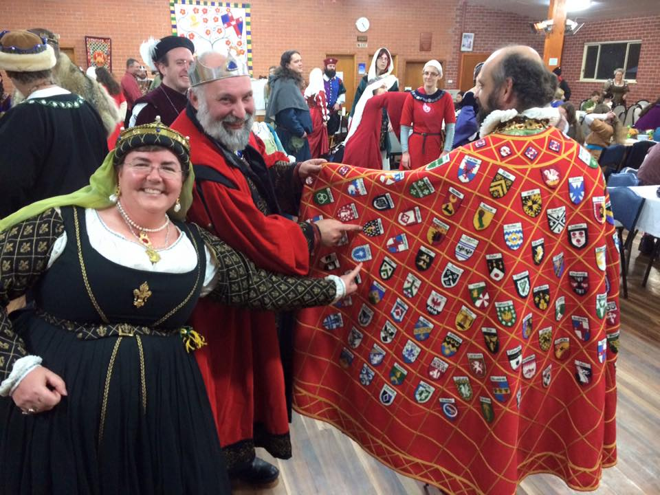 Baron Cormac is added to the Order of the Pelican. Photo by THB Ceara Shionnach, July 2015.