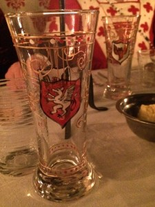 The painted glasses that were gifted to the guests had the PACC winged cornucopia badge on one side and the Politarchopolis griffin on the other. Photo by THB Ceara Shionnach, July 2015.