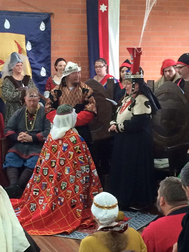 Mistress Teffania is added to the Order of the Pelican. Photo by THB Ceara Shionnach, July 2015.