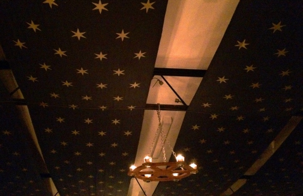 Blue fabric painted with white stars were draped from the ceiling. Photo by THB Ceara Shionnach, July 2015.