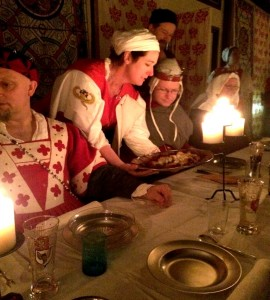 The wait staff wore red and white tabards and spent the night working hard, treating the guests like high nobility. Photo by THB Ceara Shionnach, July 2015.