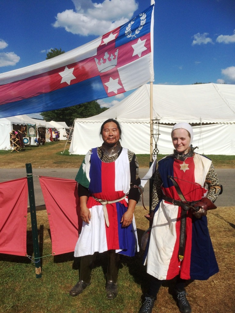 Count Kinggiyadai and Baroness Ameline prepare to represent Lochac as combat archers. Photo by THB Ceara Shionnach, August 2015.