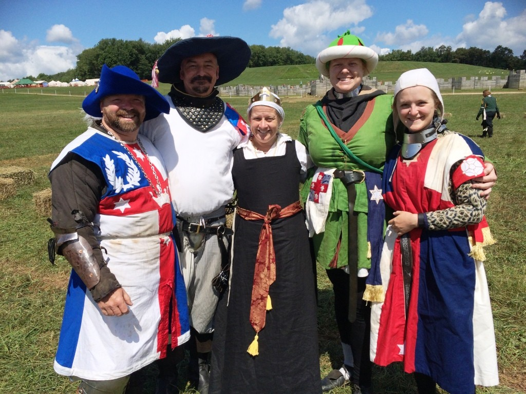 The Crown with rapier fighters representing Lochac. Photo sourced from THB Ceara Shionnach, August 2015.