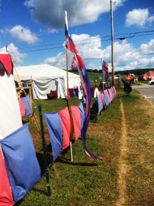 Lochac's blue-and-red front entrance at Pennsic War 44. Photo by THB Ceara Shionnach, August 2015.