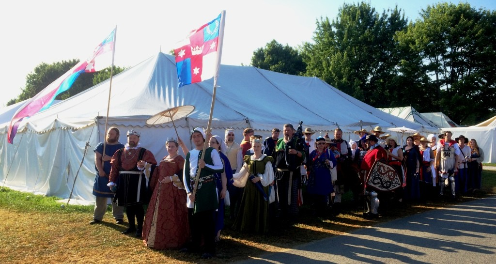 The Lochac procession assembling in front of the Lochac campsite for the march into Opening Court at Pennsic War 44. Photo by THB Ceara Shionnach, August 2015.