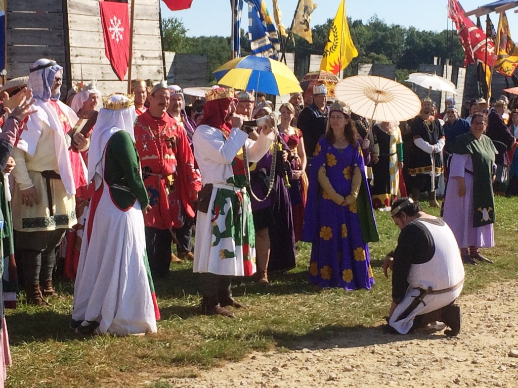 King Ragnvaldr of the Middle Kingdom blows the war horn, signifying the start of Pennsic War. Photo by THB Ceara Shionnach, August 2015.