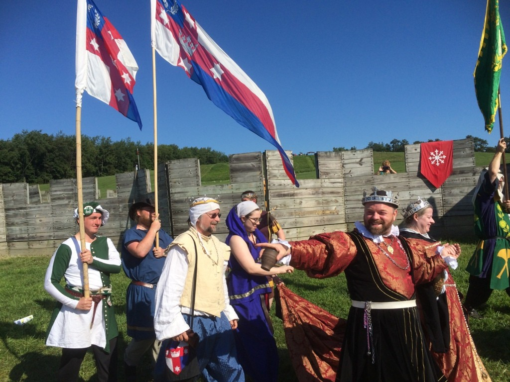Their Majesties Steffan and Branwen at Opening Court at Pennsic War 44. Photo by THB Ceara Shionnach, August 2015.