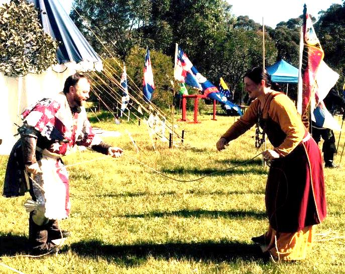 La Prova Dura III was also filled with fun and games. Here, a balancing tug-of-war game between His Majesty Steffan and Her Grace Liadan is taking place. Photo sourced from Duchess Liadan ingen Fheradaig, August 2015.