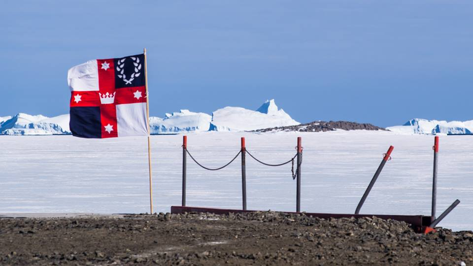 Lochacian Bob the Cold displayed a Lochac flag at Davis Station in Antarctica in response to Caid's attempt to claim the southern continent for themselves. Photo by Bob the Cold, November 2014.