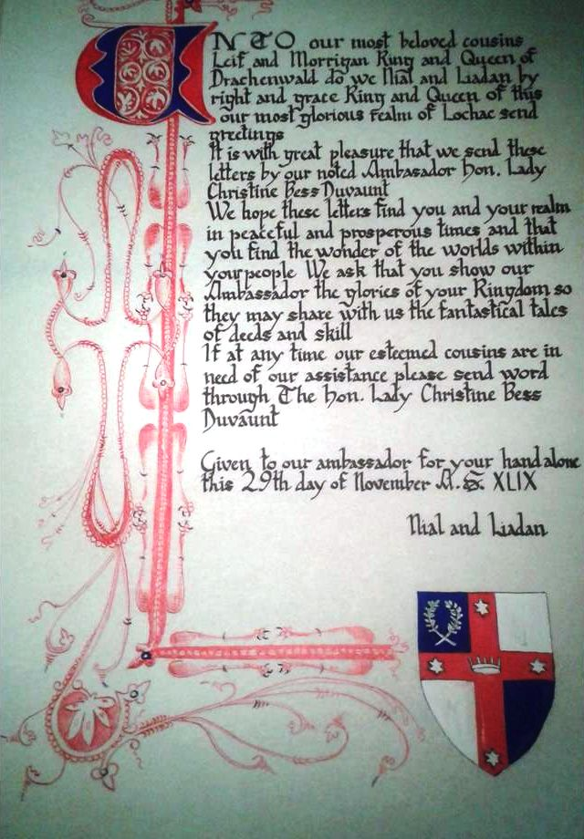 The scroll, signed by Niall II and Liadan II on 29 November 2014, sent to Drachenwald with the Ambassador THL Christine Bess Duvaunt. Photo by THL Christine Bess Duvaunt.