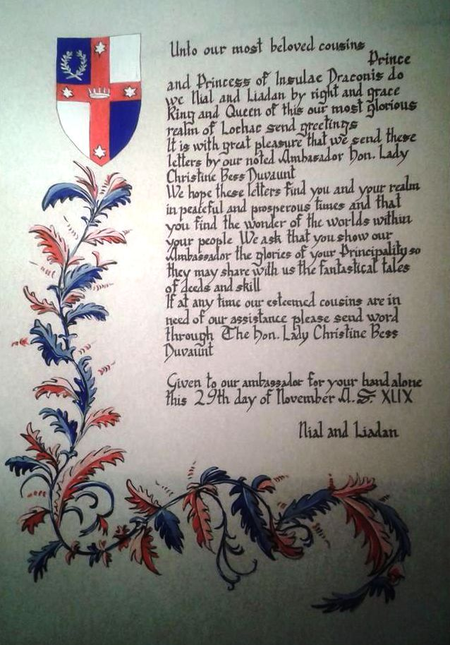 The scroll, signed by Niall II and Liadan II on 29 November 2014, sent to Insulae Draconis with the Lochacian Ambassador THL Christine Bess Duvaunt. Photo by THL Christine Bess Duvaunt.